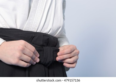 Hands that tie a hakama