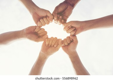 Hands together Concept. Group of young Multiethnic Collaboration Teamwork Standing Hands Together as a Circle. Unified Community Friendship with Team Support.