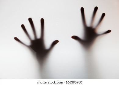 Hands touching frosted glass. Conceptual scream for help, depression, stress, panic