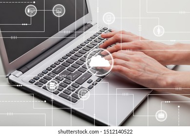 Hands touching laptop on withe table with illustration