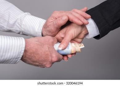 Hands transferring money