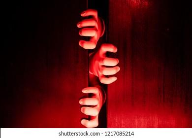 Hands tries to open the door - claustrophobia concept