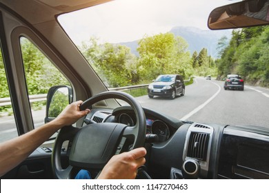hands of truck driver on steering wheel, delivery service, transportation occupation, man driving big cargo car on the road