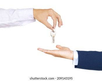 Hands of two businessman, giving and taking modern key, isolated over white background