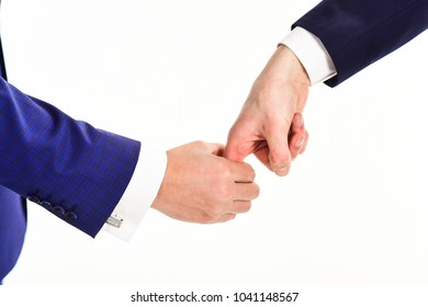 Hands of two caucasian men interaction in gesture on white background. Body language of relationships and communication. Hand catched traitor or thief in trap. Business stagnation and deadlock concept