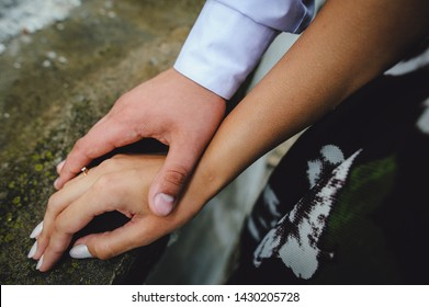 Hands of two lovers. A man holds the girl by the hand, close-up. Goosebumps