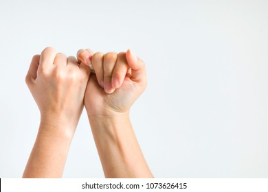Hands of two person hooking little finger together in concept to participate to do something together.