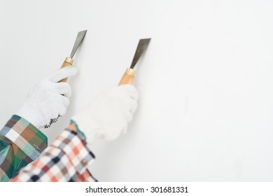 Hands of two workers plastering a wall, selective focus