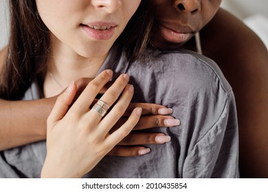 Hands of two young affectionate multiracial women