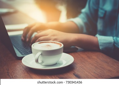 Hands typing on laptop in coffee shop ecommerc concept