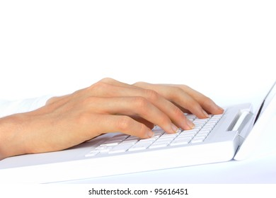 Hands typing on a white laptop - top half of image isolated on white