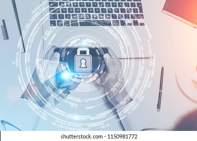 Hands of an unrecognizable man holding a smartphone in office. A digital security hologram. Toned image double exposure