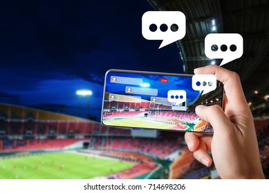 Hands use smartphones record soccer competition match in football stadium live streaming video on internet to social media comment chat to Friend