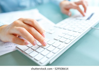 Hands using computer and credit card. Online shopping