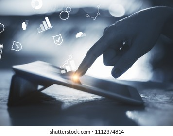 Hands using laptop with digital business interface on blurry backlit background. Hologram and finance concept. Double exposure