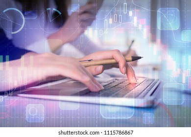 Hands using laptop with glowing forex chart on blurry background. Finance and finance concept. Double exposure