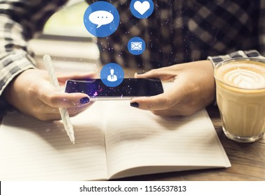 Hands using social media smartphone with icons. Comunication and technology concept