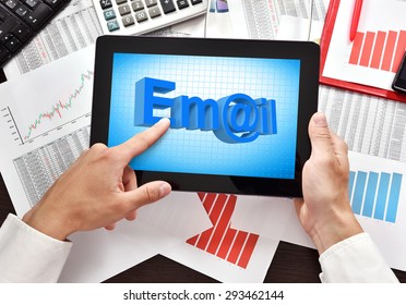 hands using tablet pc with email on screen