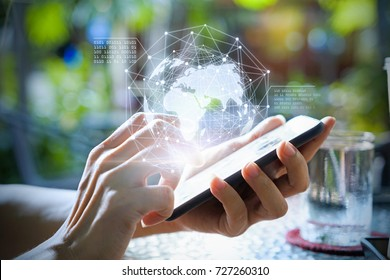 Hands using telephone device to display business data. Mobile Technology concept.
