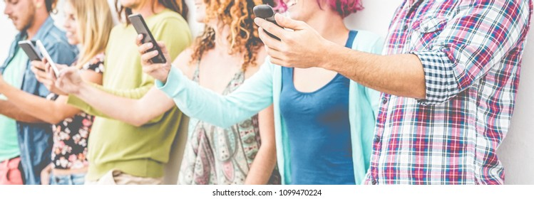 Hands view of people using smartphones outdoor - Young friends having fun with technology trends - Youth, tech, millennials generation and lifestyle concept - Soft focus on first man hand mobile phone