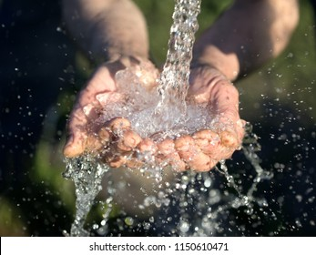 hands washing with water pouring from a tap