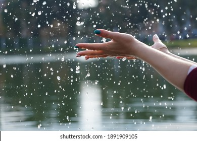 Hands and water drops on the lake