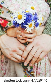 hands of the wild flowers which were fallen in love with a bouquet