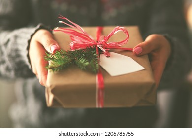 Hands of woman holding christmas gift box. Christmas