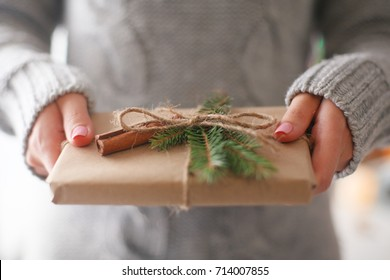 Hands of woman holding christmas gift box