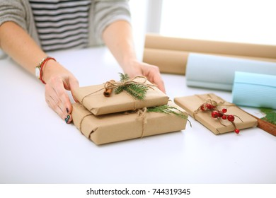 Hands of woman holding christmas gift box.