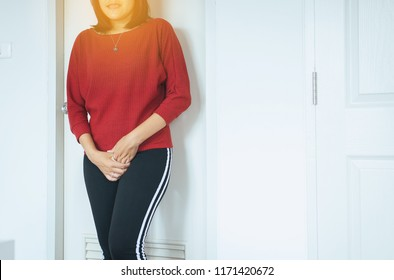 Hands woman holding her crotch,Female need to pee,Urinary incontinence