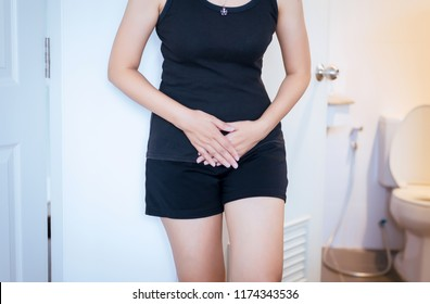 Hands woman holding her crotch,Female need to pee,Incontinence