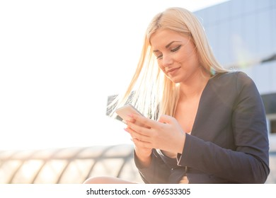 Hands of a Woman With a Mobile Phone