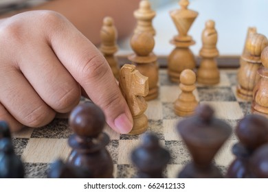 hands of woman playing chess in holidays