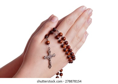 Hands of a woman Praying with Rosary, isoalted on white