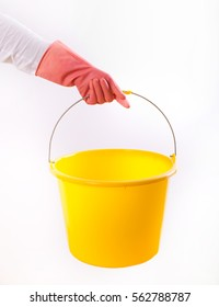Hands of woman with rubber gloves holding plastic bucket, isolated on white background