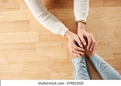 Hands of woman supporting her best friend