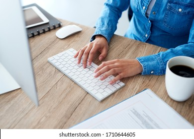 Hands of woman typing on computer keyboard
