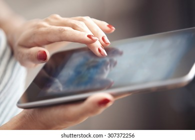 Hands of woman using digital tablet