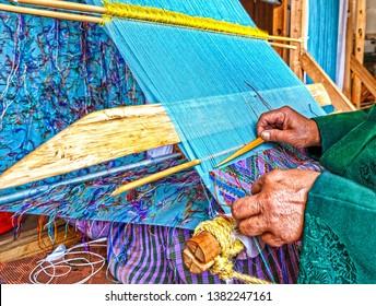 Hands of a woman weaving in Bhutan