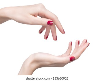 hands with woman's professional red nails manicure isolated on white