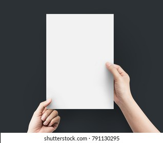 Hands women holding blank paper A4 size on top view.