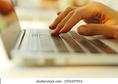 hands of women who are using the keyboard