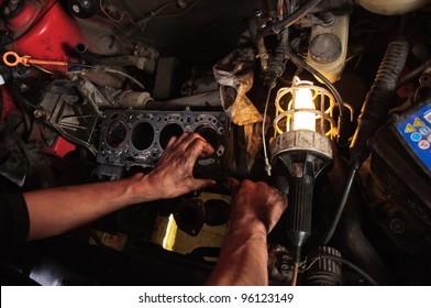 Hands of a worker repairing car interior