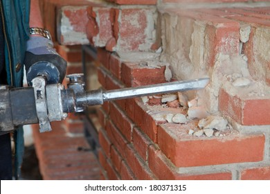 hands working  with hammer drill