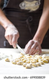 Hands working on Italian pasta, gnocchi