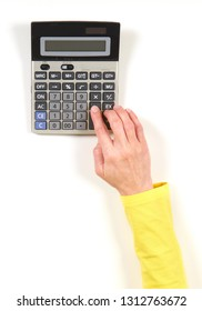 Hands in yellow jacket and black calculator on white background