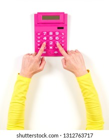 Hands in yellow jacket and red calculator on white background