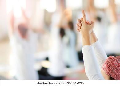Hands in yoga kundalini symbolic gesture.