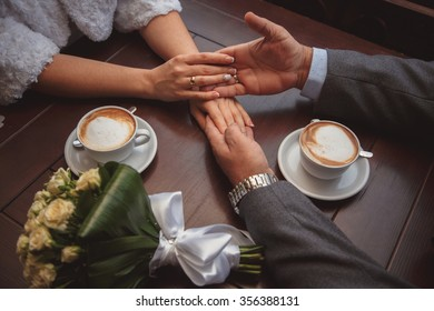 hands of young couple